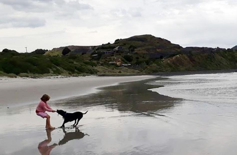 Zac McAuliffe (9) and his mother, Natalie Dilley, surf Curio Bay, the Catlins, on December 14. Photo: Ben McAuliffe