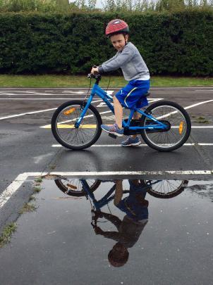 William van Raalte (6) tries his new bicycle at Fairfield Park on Christmas Day. Photo: David van...