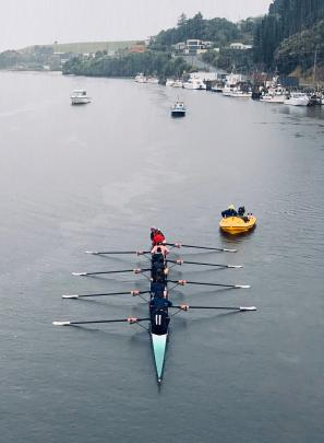 The Columba College senior rowing crew practises in heavy rain while on a summer holiday training...