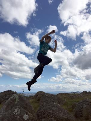 Marcus Davidson (16) jumps off a rock at the top of Pine Hill on January 3. Photo: Catherine Davidson