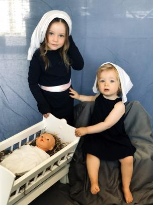 Sofia (4) and Lucy (1) Johnston pose as Mary and Joseph to celebrate Chrsitmas. Photo: Chloe...