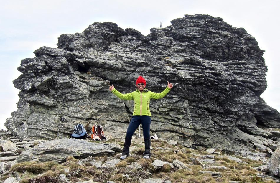 A rocky outcrop provides a little shelter for Nora Hastings, of Wanaka, as she celebrates her...