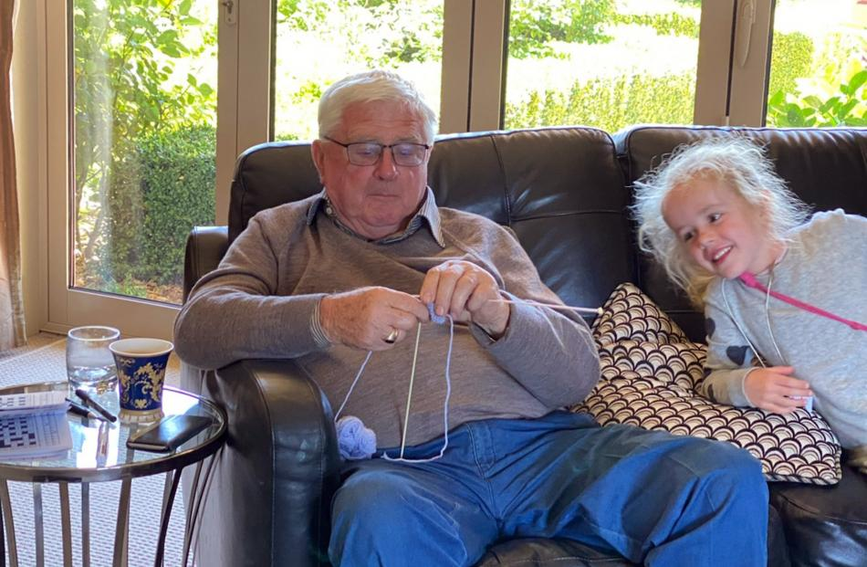 George Cleland (79) interests his great-granddaughter Ivy Cowley (6) in the art of knitting at his home in Luggate. Photo: Christine Cleland