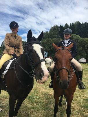 Katie Boakes (19, left), of Ohoka (near Rangiora), and her mount Pops, catches up with Taylah Dolan (13), of Loburn (near Rangiora), and her horse Mickey. Photos: David Hill
