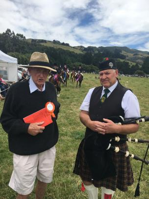 Horse convener Keith Vogan (left), of Duvauchelle, chats to lone piper Glen Vickery, of the...