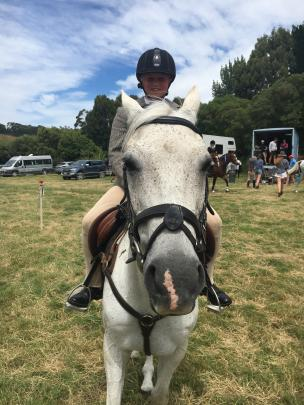 Lizzie Wright (11), of Little River, and her horse Wombat are ready to compete in the jumping...