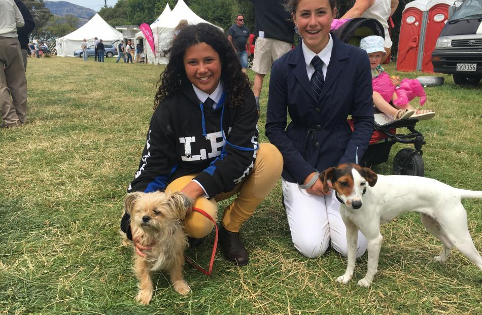 Niamh Shaw (12, left), of Takamatua (near Akaroa) and her dog Muffin and India Phillips (12), of...