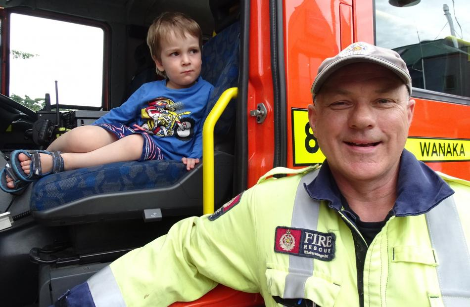 Tom Houghton (2), of Christchurch, and Wanaka volunteer Fenz firefighter Clayton Sargisson.