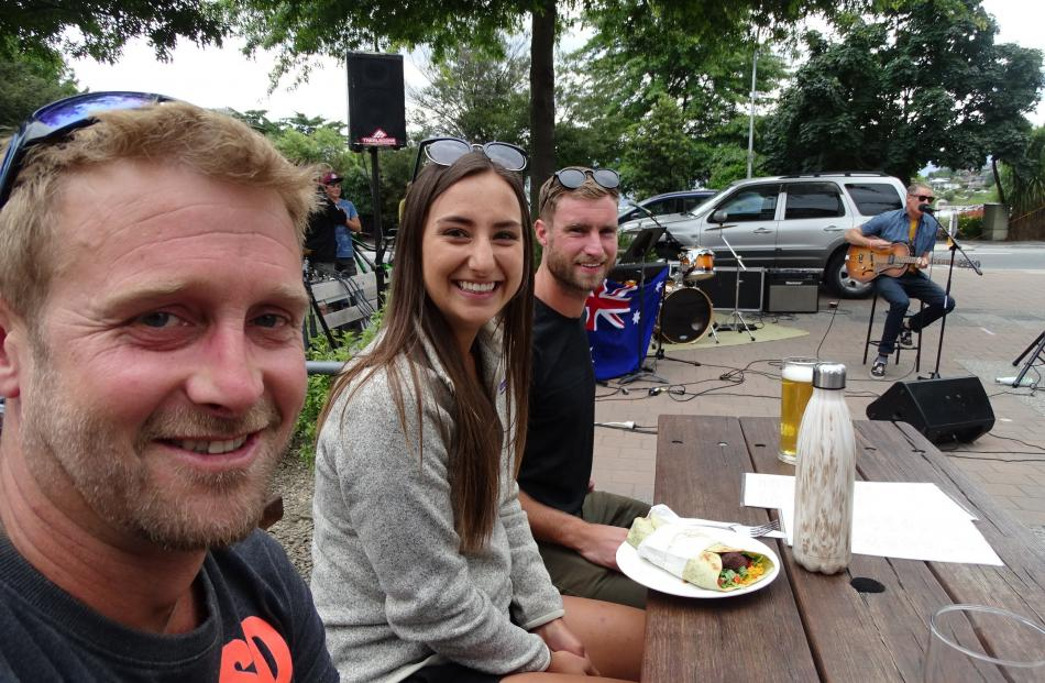 Blake Reid, Elle Dice and Paul Hodgson, all of Wanaka, watching Angus Pettegrew, of Queenstown,...