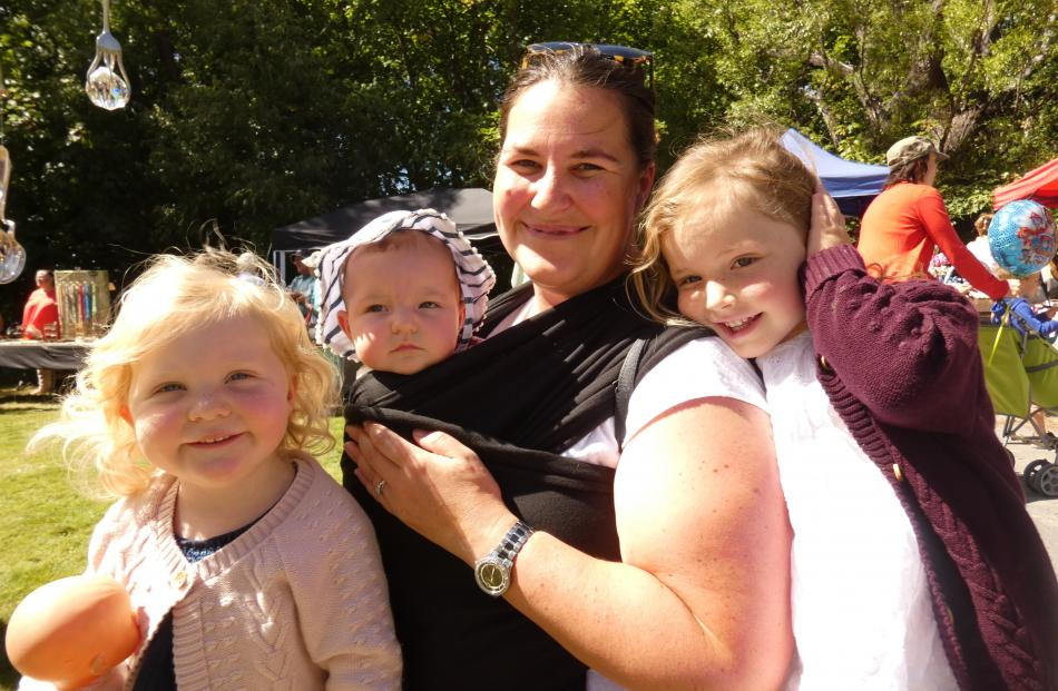 Siblings Olivia (2), Ruby (four months) and Charlotte (4) Naylor, with their mum Sarah Naylor,...
