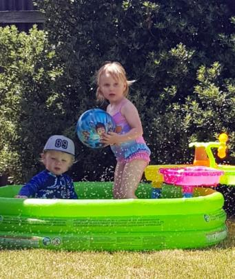 Bentley Aitkenhead (20 months) and Penelope Bell (3) enjoy some fun in the paddling pool during...