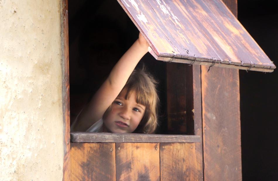 Ilaria Silby (5) explores the historic Chinese village in Arrowtown. Photo: Jason Silby