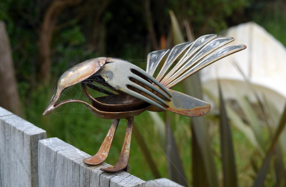 A fantail sculpture on a fence in Harwood.