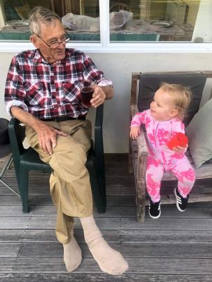 Dave Sinclair, of Alexandra, shares a blackcurrant drink and a joke with granddaughter Carmi...