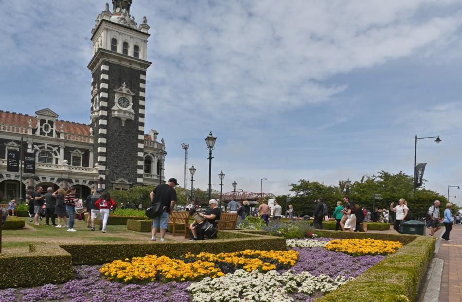 A crowd of cruise ship passengers enjoy the sights at the Dunedin Railway Station yesterday.