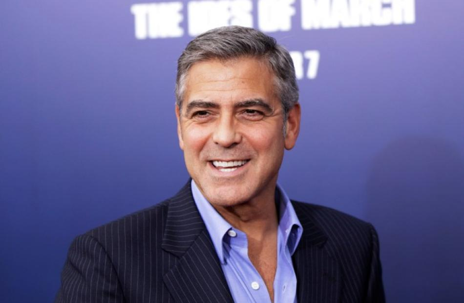 Director and cast member George Clooney smiles as he arrives for the premiere of his film 'The...