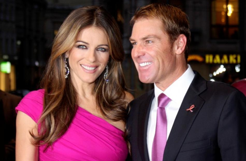 Former Australian cricketer Shane Warne and his fiancee, actress and model Liz Hurley, pose for a...