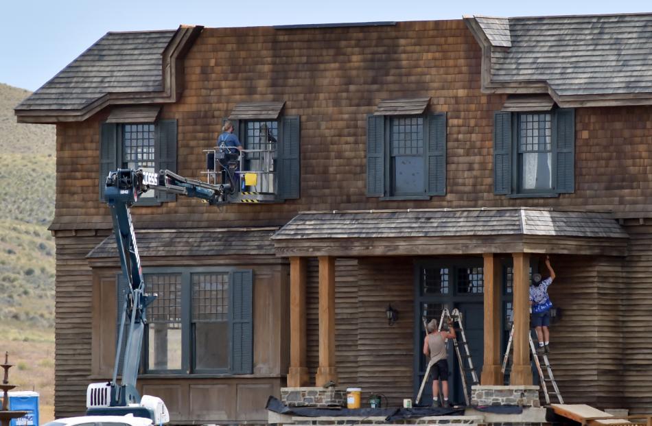 Carpenters work on the set.