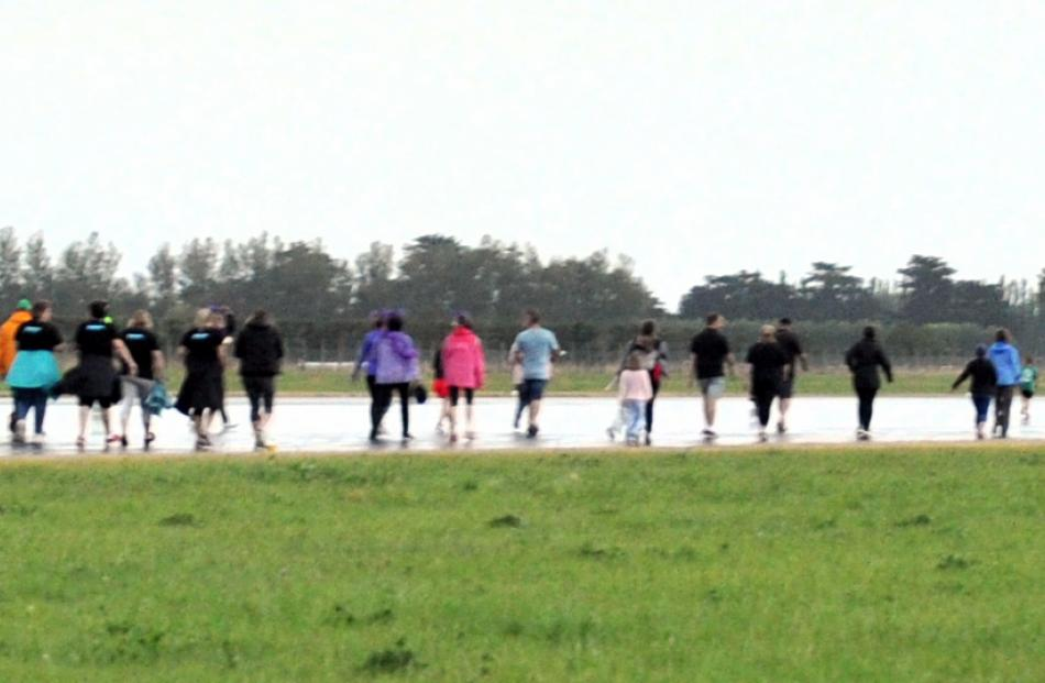 The runway at Dunedin Airport was uncharacteristically filled with people during yesterday's Run...