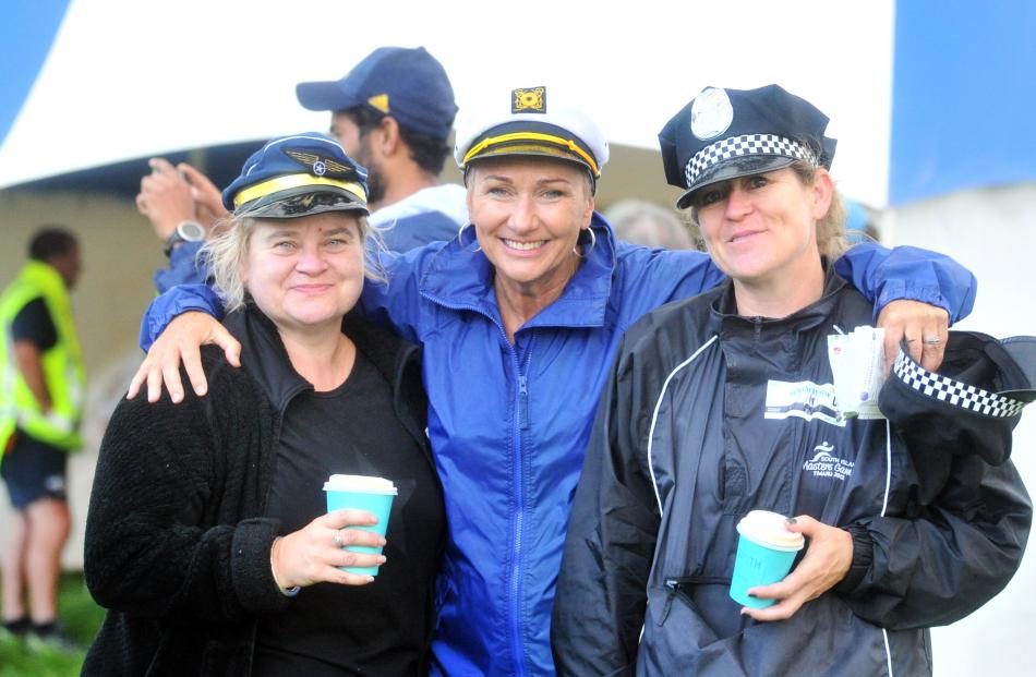 Dressed in uniforms are (from left) Bex Hurley, Jaqueline Tangney and Nicola Jukes of Dunedin.