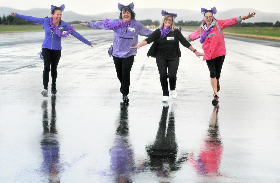 Purple team members (from left) Melanie Whyte, Zaklina Cvjetan, Suzanna Beck and Jeanette Tromop...