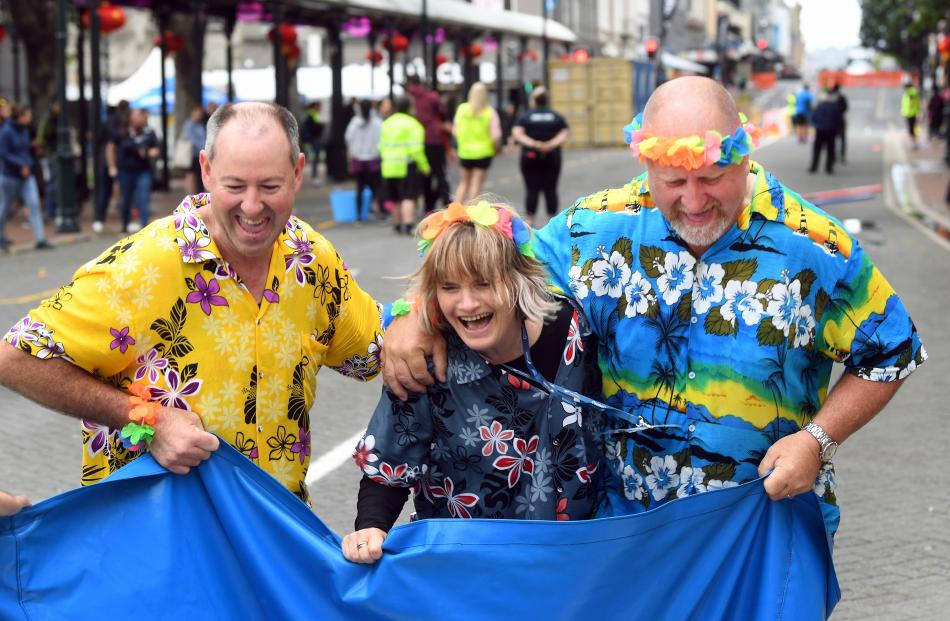 Trying to work out how to move in a giant sack race are (from left): Michael Dow, Louise...
