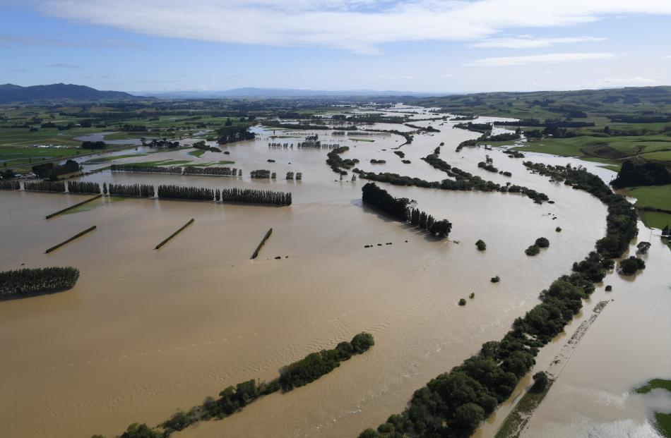 The Mataura River flows across farmland near Gore.