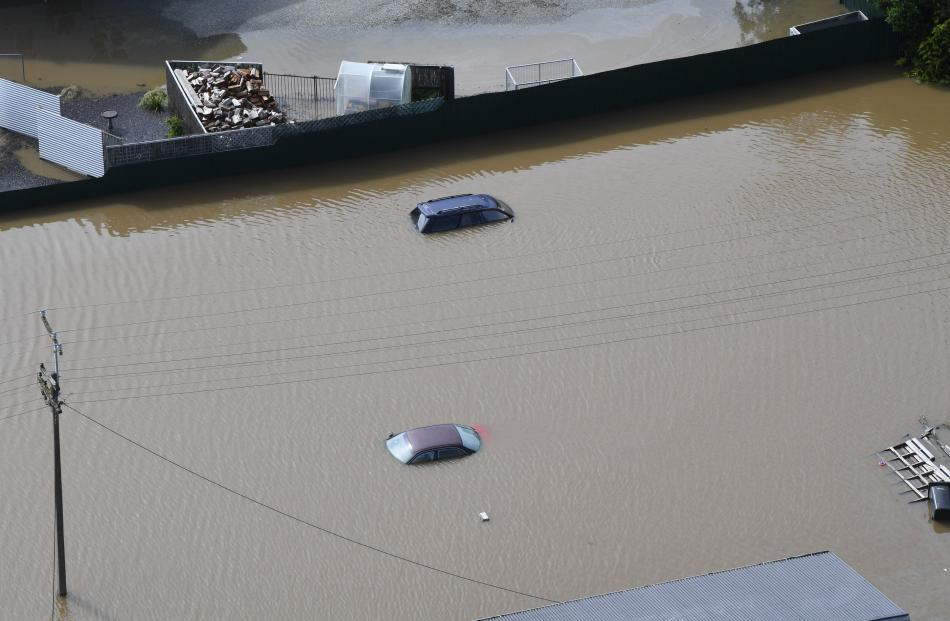The roofs of parked cars peek above the floodwater in Gore on Wednesday.