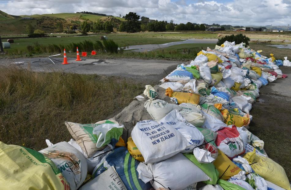 Sandbags sit dry after the floodwater receded on Thursday.