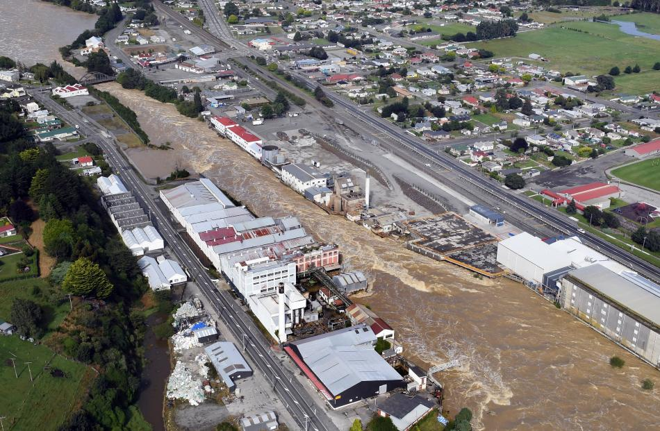 The swollen Mataura River rips through the town on Wednesday. PHOTOS: STEPHEN JAQUIERY