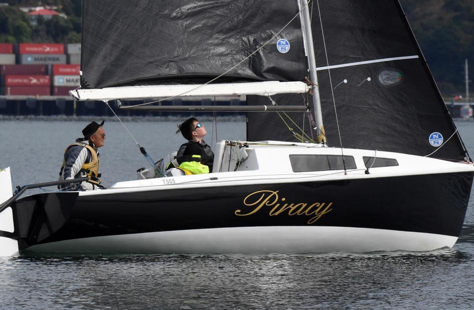 Piracy, skippered by Vince Williams, of Christchurch, with Sam Connor, picks up some knots.