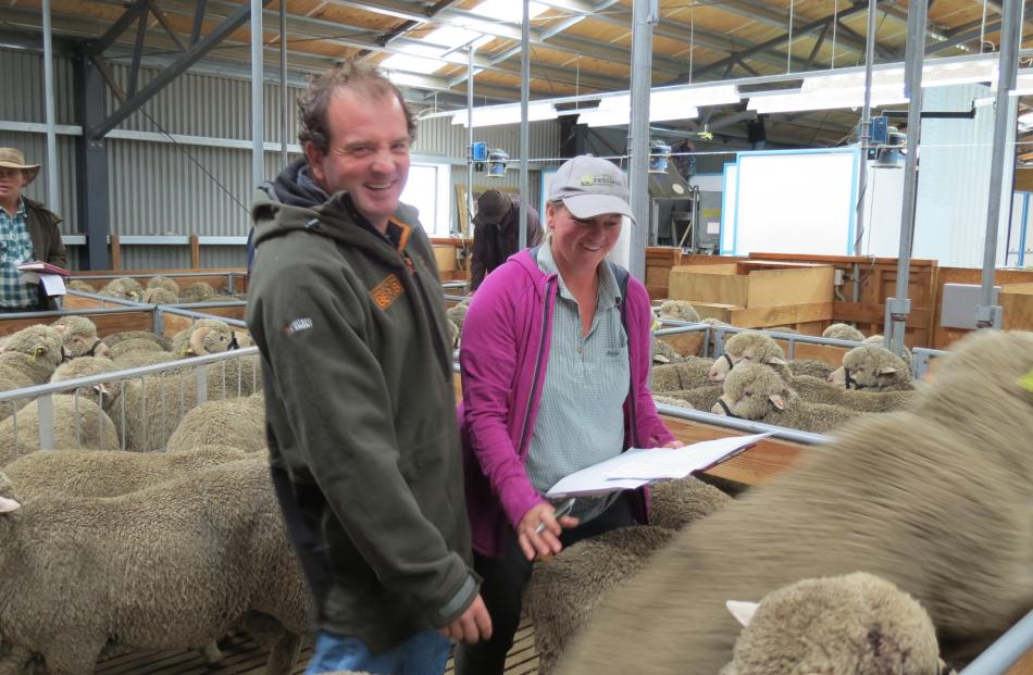 Ben and Vanessa Hore, of Becks, make a selection during Earnscleugh Station's merino ram sale...