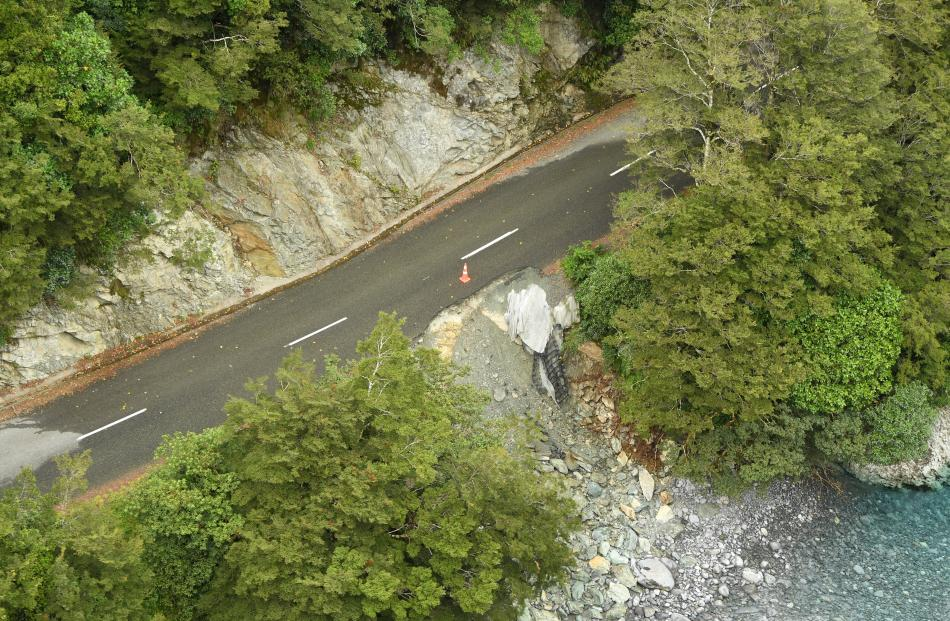 Contractors were reviewing the state of the road to  determine how long it would take to repair...
