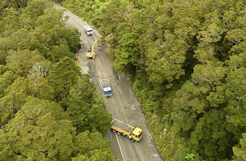 Heavy machinery was sent in to assess and clean-up the wreckage along State Highway 94 in to...
