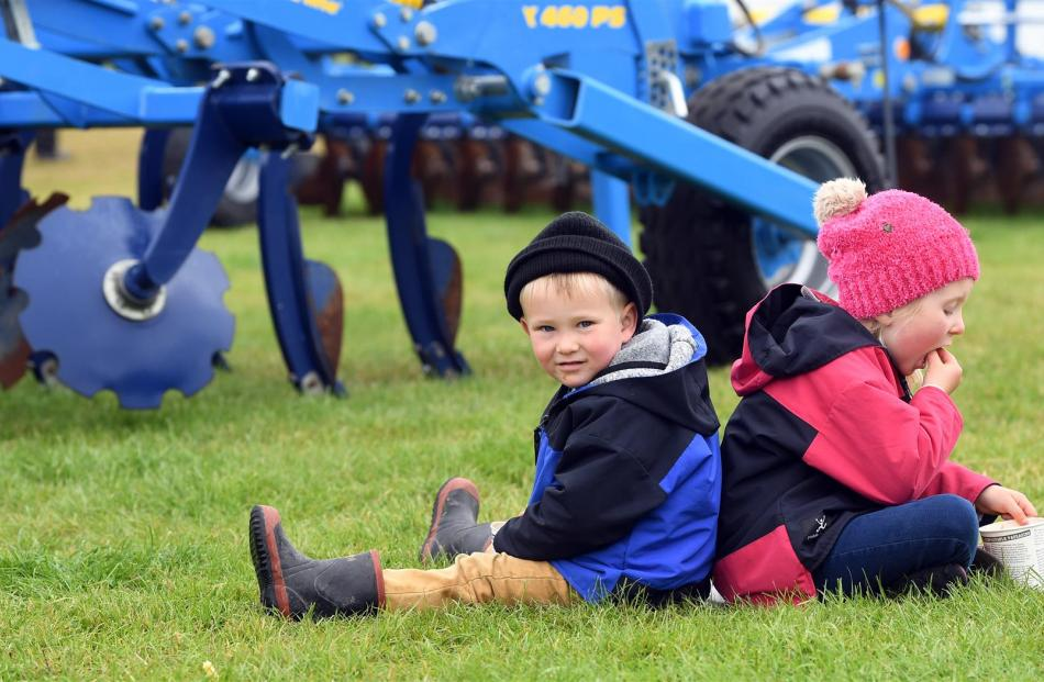 With a Southern Field Days programme spread on the damp grass, Liam (3) and Arabella Wilson (5),...