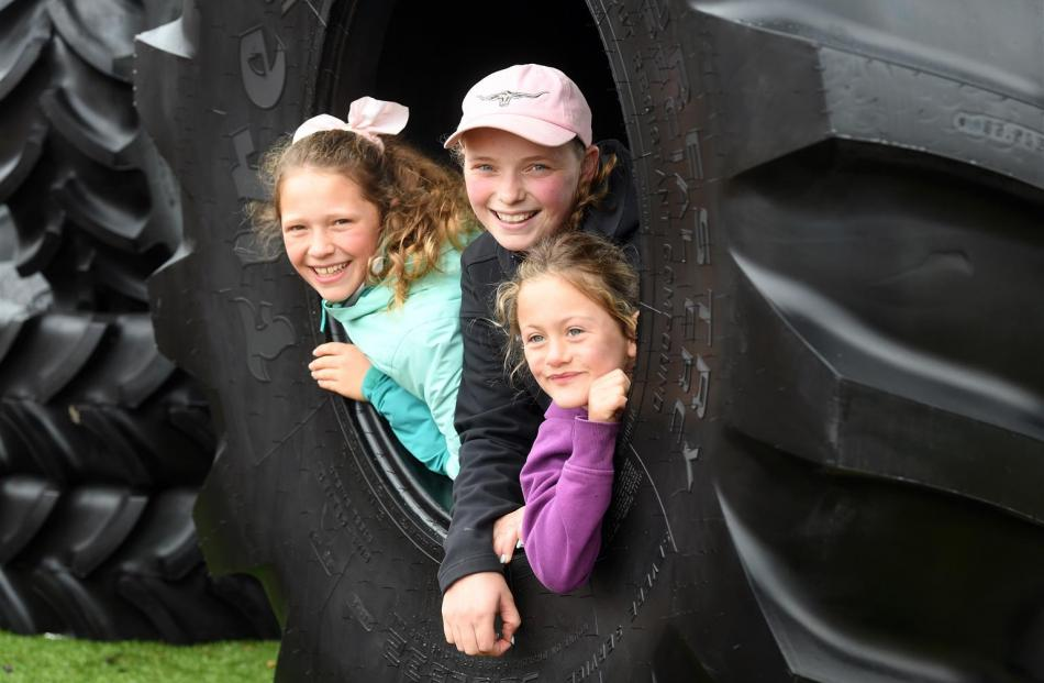 Friends (from left) Amelia Nicholson (12), Meg Miller (12) and Ashlyn Dillon (6), all of...