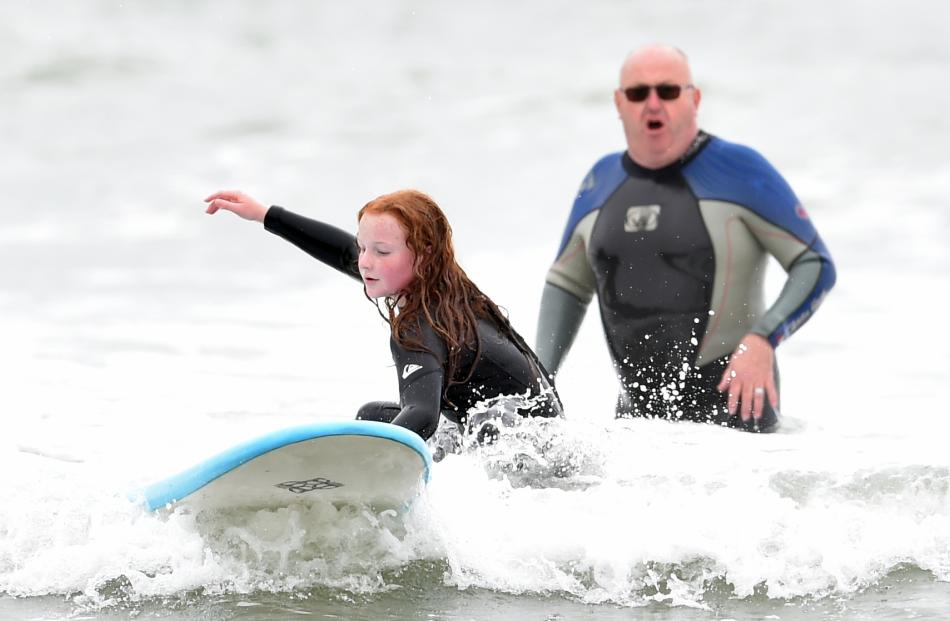 Big Rock School pupil Imogen Lucking (12) tries to catch a wave during a water safety class with...
