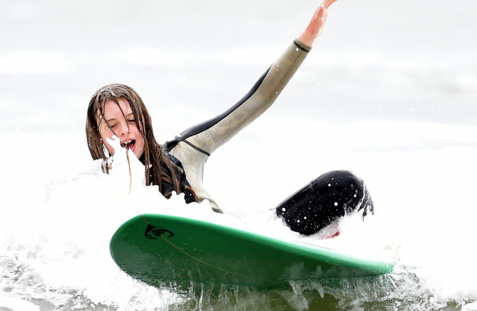 Isobelle Grey (12) takes a tumble from her surfboard.