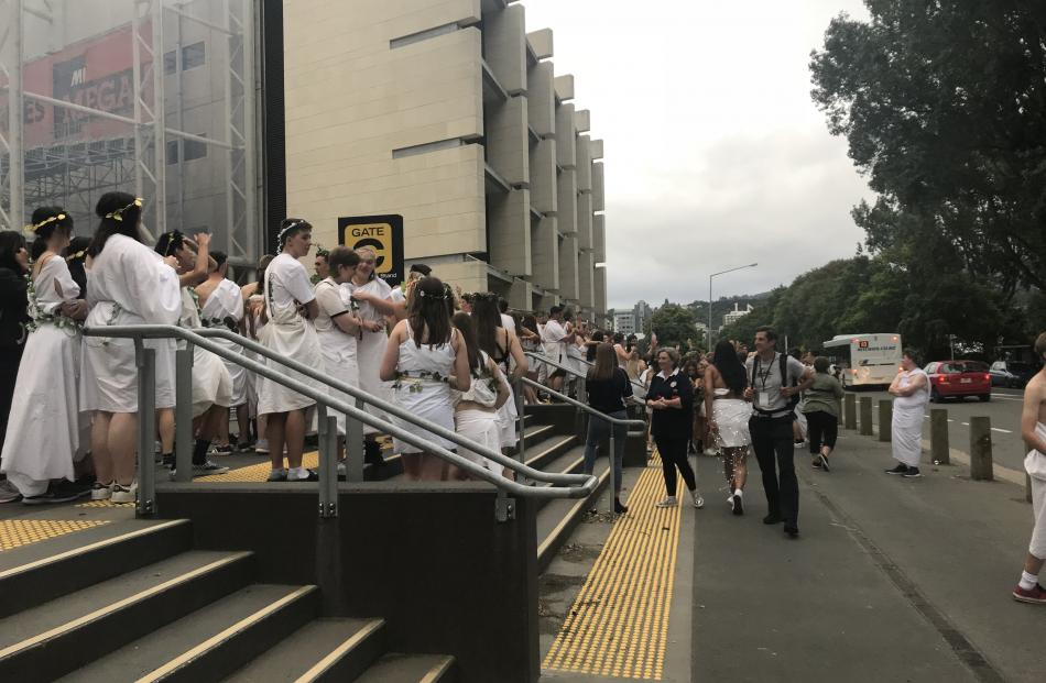 Students outside the stadium before the annual toga party. Photo: Daisy Hudson