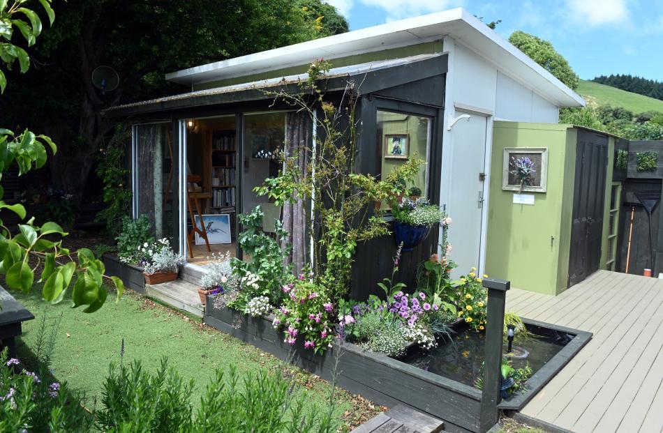The art studio has sliding glass doors that open to the garden.