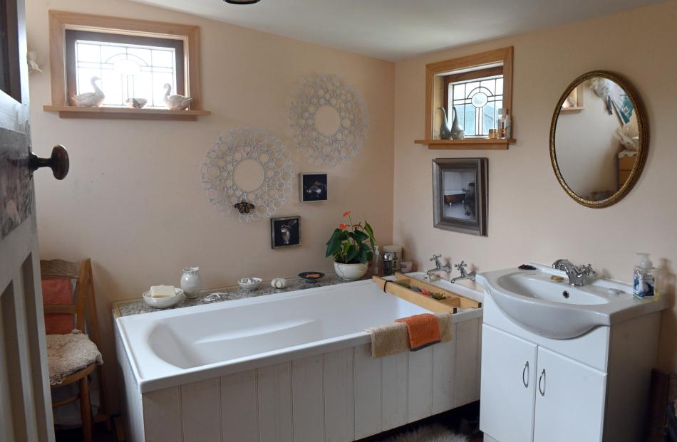 Still in its original location, the bathroom has been renovated.