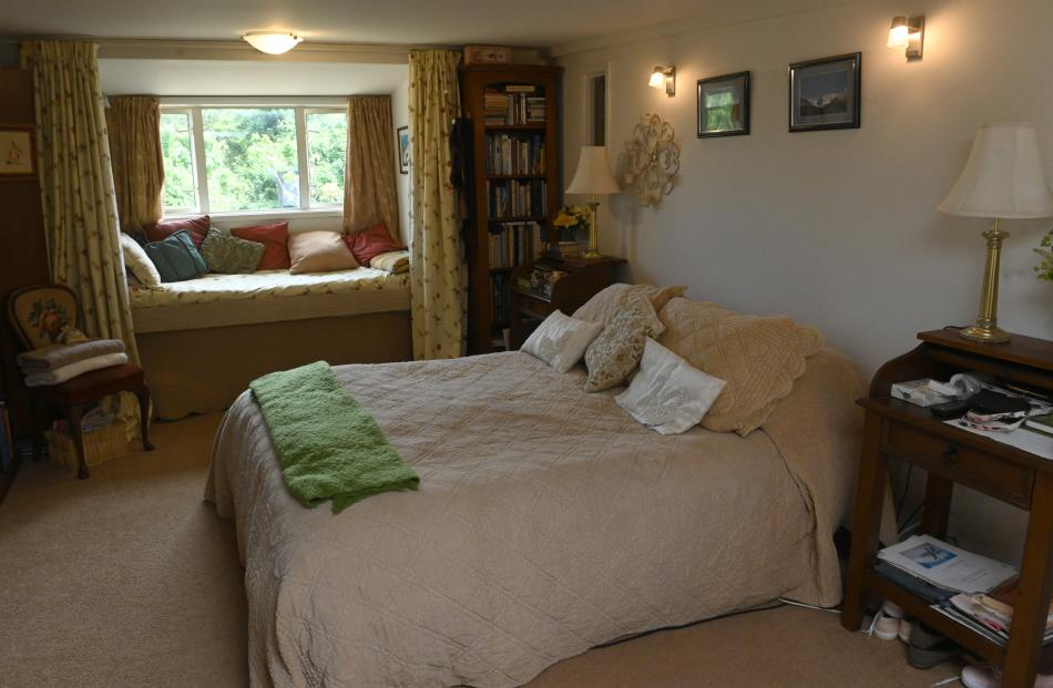 The window seat is a cosy spot to sit in the bedroom.