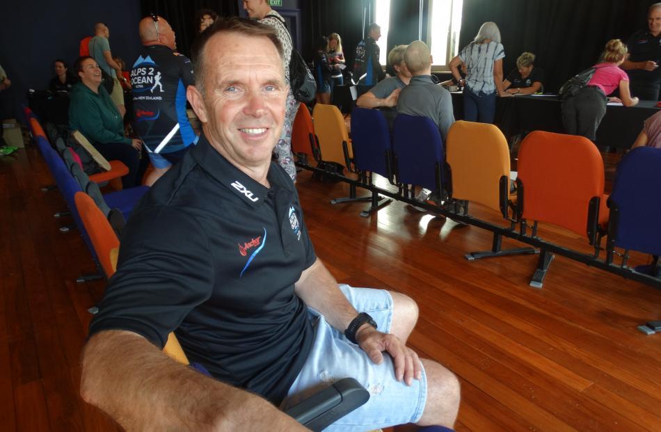 Alps 2 Ocean Ultra organiser Mike Sandri oversees race registrations on Thursday ahead of the...