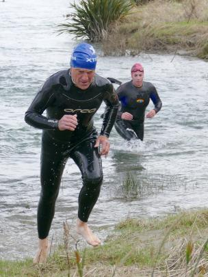 Bryce Clark, of Lovells Flat, emerges from the Clutha River. PHOTOS: RICHARD DAVISON