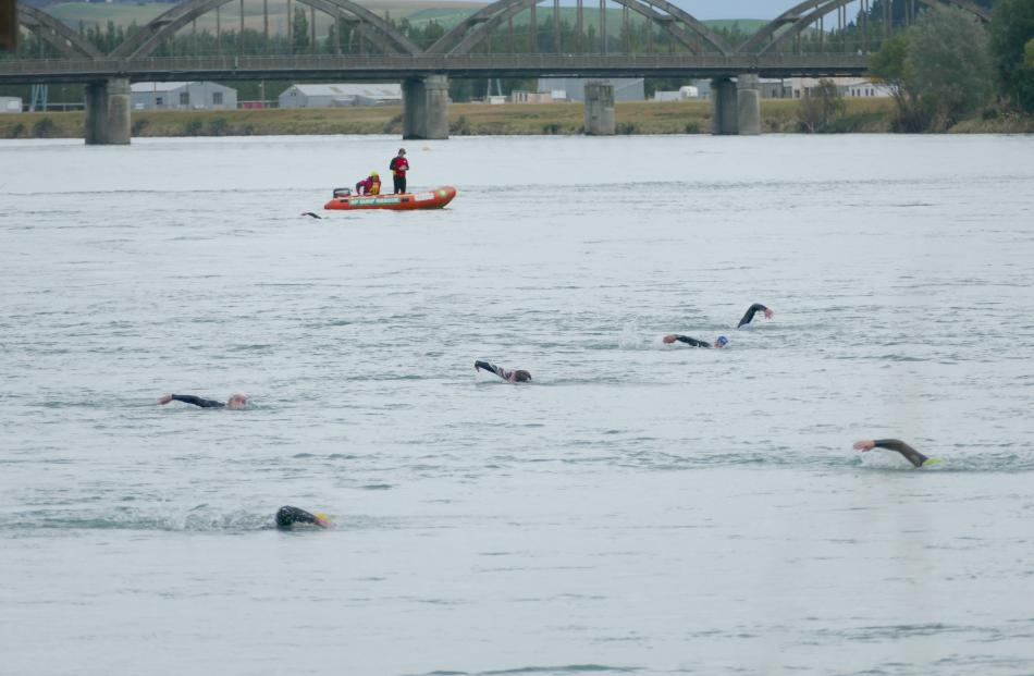 Competitors in the Ken Milne Classic triathlon take on the mighty Clutha River near Balclutha...