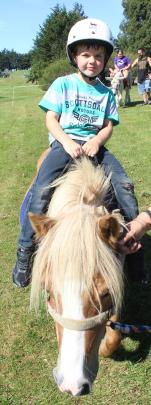 Rocky the miniature horse gave Jaxon Murch his first riding experience at the Family Fun Day.