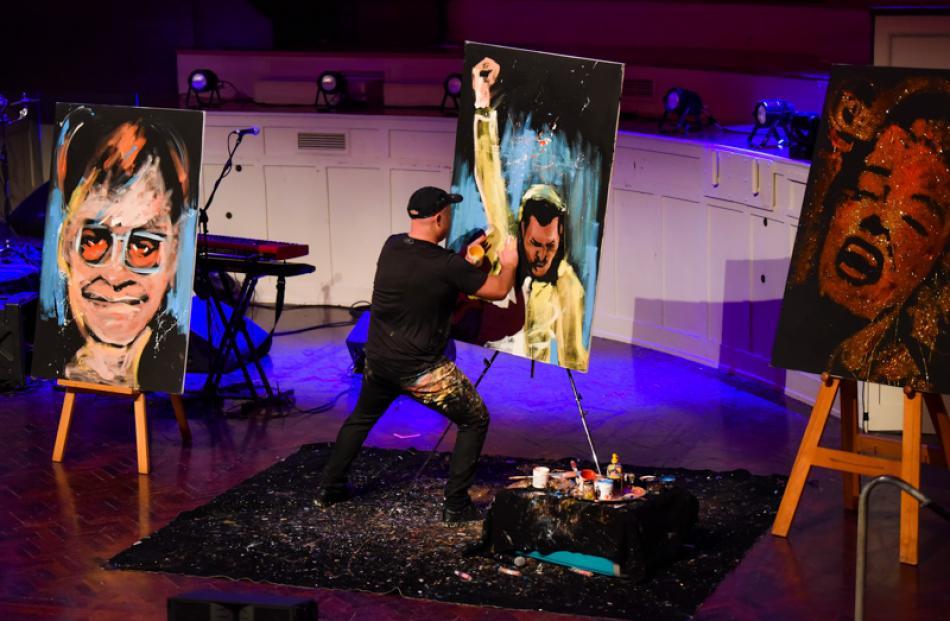 Brad Blaze puts the final touches to his Freddie Mercury portrait.