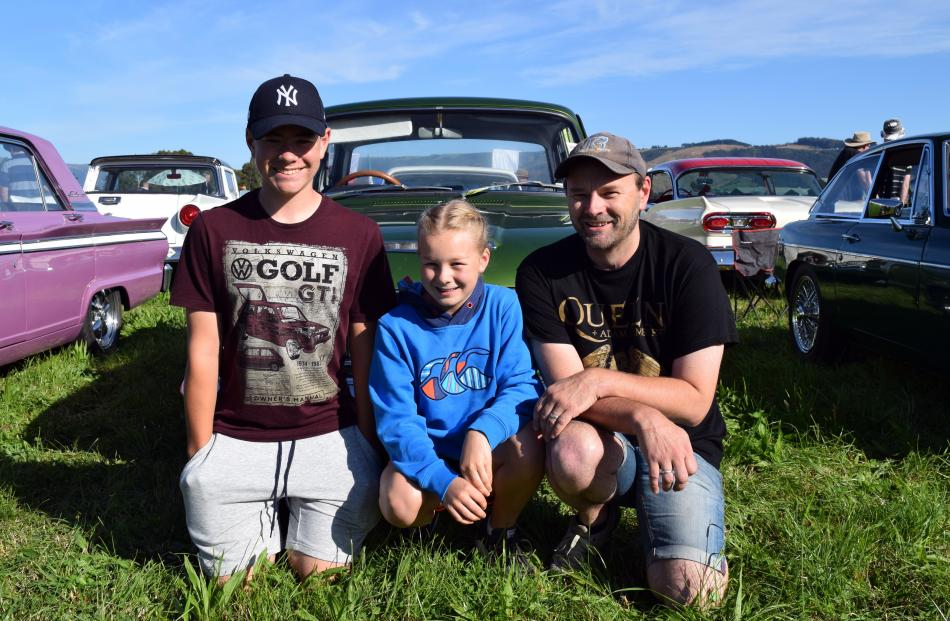 Devon (15), Ruby (11) and Mark Scott, all of Mosgiel, relax by a 1964 Ford Cortina GT 