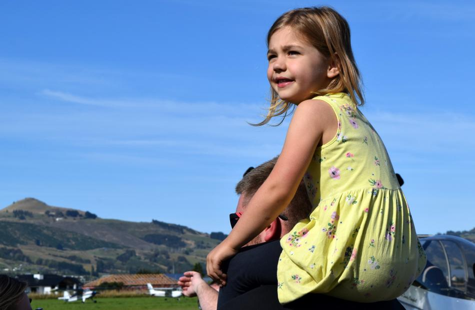 Ella Third (4) watches a flying demonstration. PHOTOS: SHAWN MCAVINUE