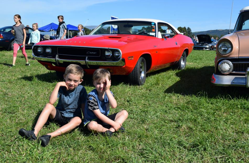 Brothers Harley (7) and Jordan (5) Richardson, of Mosgiel, relax by a 1970 Dodge Challenger.
